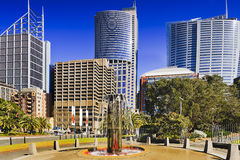 RBG Fount City street. Tall skyscrapers on the streets of Sydney behind memorial fountain at the Royal Botanic Garden in city downtown on a sunny summer day Royalty Free Stock Photos
