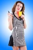 Árbitro de la mujer con la tarjeta Imagenes de archivo