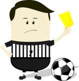 ?rbitro del f?tbol que muestra la tarjeta amarilla Foto de archivo