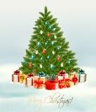 Árbol de navidad con el fondo de los presentes Fotografía de archivo libre de regalías