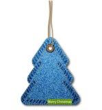 Árbol de navidad en la textura del dril de algodón Foto de archivo libre de regalías