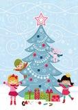 Árbol de navidad y cabritos felices Imagen de archivo libre de regalías