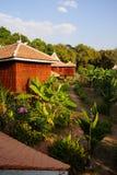 Árboles de la casa y de plátano del Khmer Imagenes de archivo