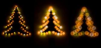 3 árboles de navidad del bokeh Fotografía de archivo