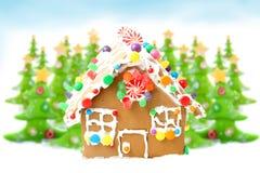 Árboles de navidad y casa de pan de jengibre Fotografía de archivo libre de regalías