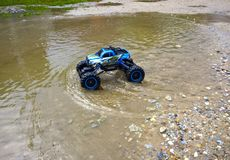 Rc auto model rides through the water stock images