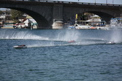 RC Boat Racing by the Bridge Stock Photo