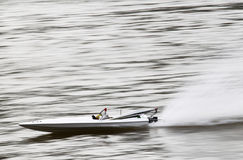 RC boat speeding on a lake. Remote controlled toy boat speed across a lake royalty free stock photo