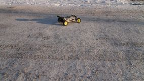RC buggy car spinning on snow stock video