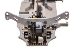 RC Car Chassis and Parts. Being built to form a radio controlled race car Stock Image