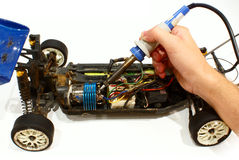Rc car fixing. Soldering of radio controlled model toy car stock photo