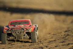 Rc car going fast. Low angle shot of an RC car kicking up dust Royalty Free Stock Images