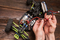 Rc car model toy electronics repair. Rc radio control car crawler model toy electronics repair. Green toy suv in repairshop workplace, free space Royalty Free Stock Image