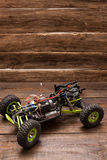 Rc car model toy on wooden background Royalty Free Stock Photography