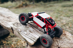 Rc car overcoming wooden log, free space Royalty Free Stock Photos