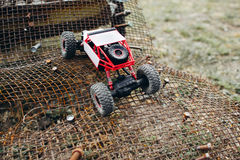 RC crawler riding rough surface og grille stock photo