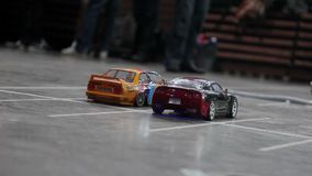 RC drift cars. Two RC drift cars indoors stock footage