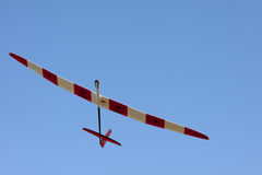 RC glider flying in the blue sky Royalty Free Stock Photography