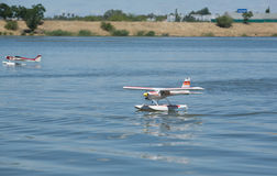 RC Hydroplane landing on water Royalty Free Stock Images