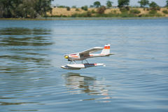 RC Hydroplane landing on water Royalty Free Stock Photo
