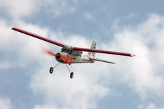 RC model airplane flying in the blue sky. Closeup Stock Photo