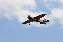 RC model airplane flying in the blue sky Royalty Free Stock Image
