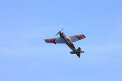 RC model airplane flying in the blue sky Royalty Free Stock Photography