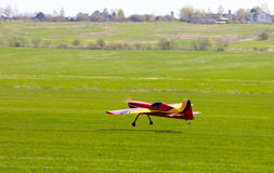 RC model airplane lands on the grass Stock Image