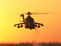 RC Model Hind Scale Helicopter. Flying in Flight at Sunset Stock Photos