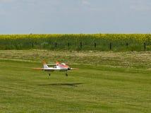 RC Model Jet Landing. Radio Controlled Model Jet Landing on a Grass Field Stock Image