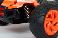 RC model rally, off road race buggy close up detail. Macro car shock absorbers stock image