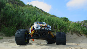 RC Nitro monster truck at the beach. 1/8 Scale radio control nitro powered monster truck on the beach Stock Photography