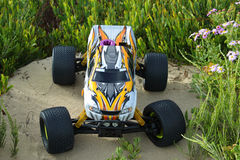 RC Nitro monster truck. 1/8 Scale radio control nitro powered monster truck on coastal dunes Royalty Free Stock Images