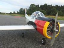 Rc plane. Radiocontrolled plane on tarmac Royalty Free Stock Photos
