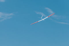 RC soaring plane on blue sky Royalty Free Stock Images