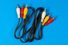 RCA cables on blue background royalty free stock image