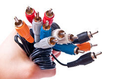 RCA plug in hand Royalty Free Stock Photos