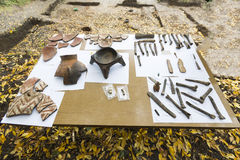 Аrchaeological excavations Human bones and pottery. Human bones and pottery are shown on a table from archaeological excavions in Bulgaria Stock Photography