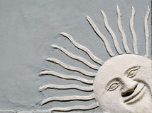 Аrchitectural element smiling  amd peering  Sun Royalty Free Stock Photo