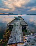 Rckety Island Dock with Mountains Royalty Free Stock Images