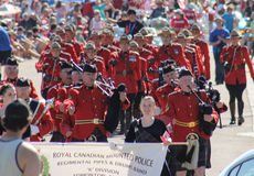 Rcmp marching band in Parade route Royalty Free Stock Images
