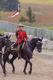 RCMP Musical Ride in Ancaster, Ontario. Our proud RCMP performing their Musical Ride performance at the Ancaster Fairgrounds at 630 Trinity Road in Ancaster Royalty Free Stock Image