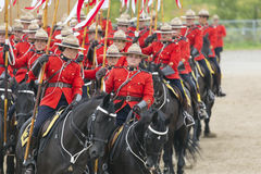 RCMP Musical Ride in Ancaster, Ontario. Our proud RCMP performing their Musical Ride performance at the Ancaster Fairgrounds at 630 Trinity Road in Ancaster Royalty Free Stock Photography