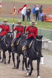 RCMP Musical Ride in Ancaster, Ontario. Our proud RCMP performing their Musical Ride performance at the Ancaster Fairgrounds at 630 Trinity Road in Ancaster Royalty Free Stock Photo