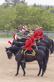 RCMP Musical Ride in Ancaster, Ontario. Our proud RCMP performing their Musical Ride performance at the Ancaster Fairgrounds at 630 Trinity Road in Ancaster Stock Images