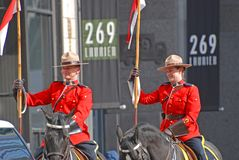 RCMP riding in Saint Patrick's Day parade, Ottawa, Canada. Ottawa, Canada - Mar. 10, 2012: RCMP riding in Saint Patrick's Day Parade in Ottawa, Canada Royalty Free Stock Image
