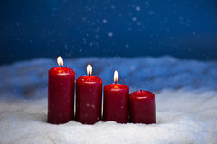 3rd Advent. Candles in snow and snowfall Stock Images
