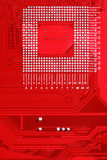 Röd bakgrund för textur för strömkretsbräde av datormoderkortet Fotografering för Bildbyråer