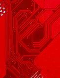 Röd bakgrund för textur för strömkretsbräde av datormoderkortet Arkivbild