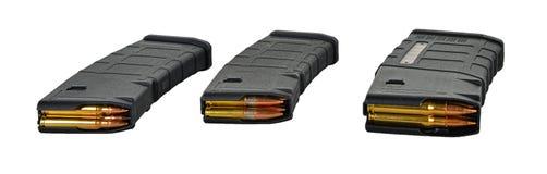 3 30rd compartimentos da AR carregados com os calibres diferentes Foto de Stock